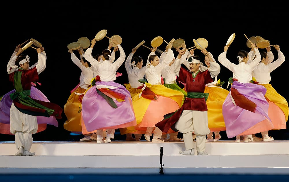 Dancers perform during the closing ceremony of the 17th Asian Games in Incheon, South Korea.
