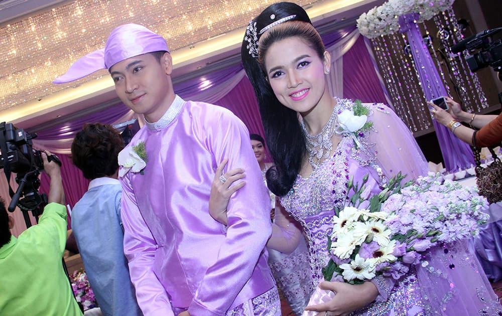 Myanmar models present traditional bridal dresses creation by local designers during 'Chatrium Dream Wedding Fair 2014', at Chatrium Hotel in Yangon, Myanmar.