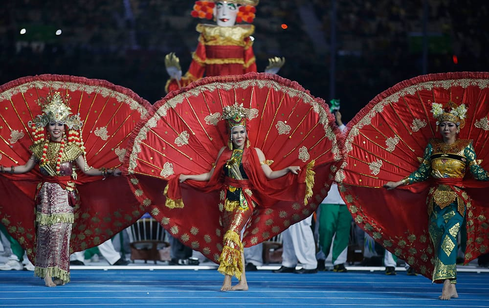 Dancers from the next host country Indonesia perform during the closing ceremony of the 17th Asian Games in Incheon, South Korea