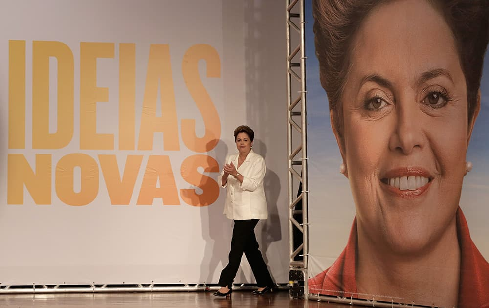 Brazil's President Dilma Rousseff, presidential candidate for re-election of the Workers Party, PT, arrives to attends a press conference, in Brasilia, Brazil.