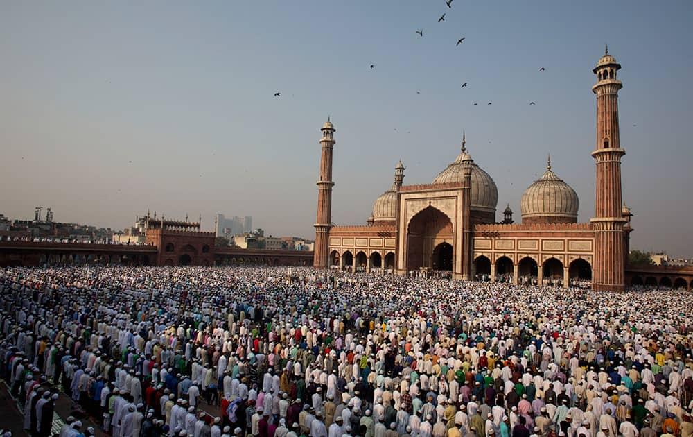 Muslims offer prayers to mark the festival of Eid al-Adha at Jama Masjid in New Delhi.