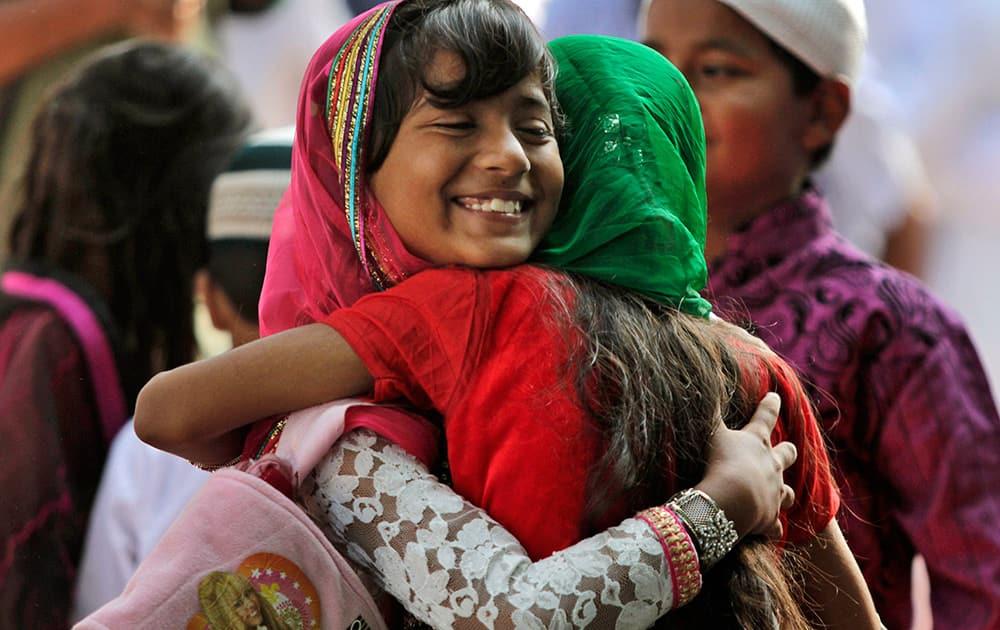 Muslim devotees hug each other after offering prayers on Eid al-Adha in Kolkata.