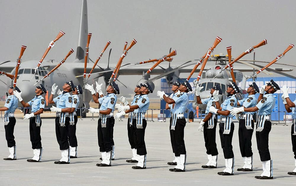 Air Force personnel perform with guns during the full dress rehearsal for the Air Force Day Parade, at Air Force Station Hindon in Ghaziabad.
