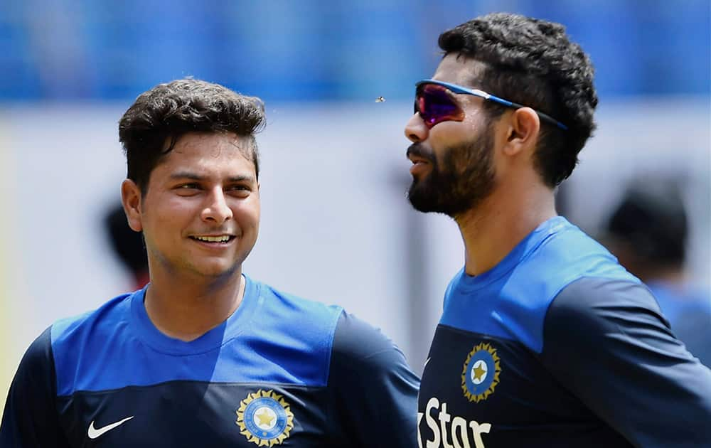 Ravindra Jadeja with newcomer Kuldeep Yadav during the practice session for the first ODI match against West Indies at Jawaharlal Nehru Stadium in Kochi.