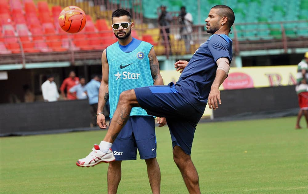 Virat Kohli and Shikhar Dhavan during a practice session ahead of the first ODI match against West Indies at Kochi International Stadium.