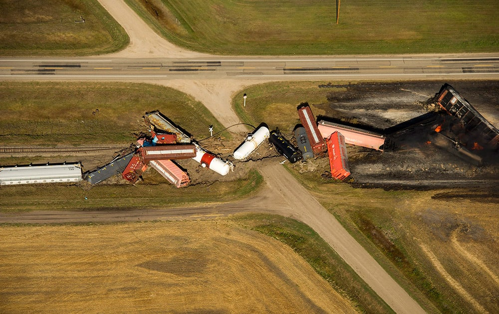 This aerial photo shows a Canadian National Railway Company freight train carrying dangerous goods that derailed and caught fire near the town of Wadena, Saskatchewan.