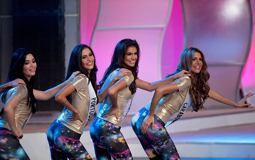 Contestants, from left, Fabiola Briceno from Monagas State, Astrid Moller from Portuguesa State, Maria Jose Marcano from Costa Oriental and Margreth Isava from Carabobo State, perform during a rehearsal for the Miss Venezuela beauty contest in Caracas, Venezuela.