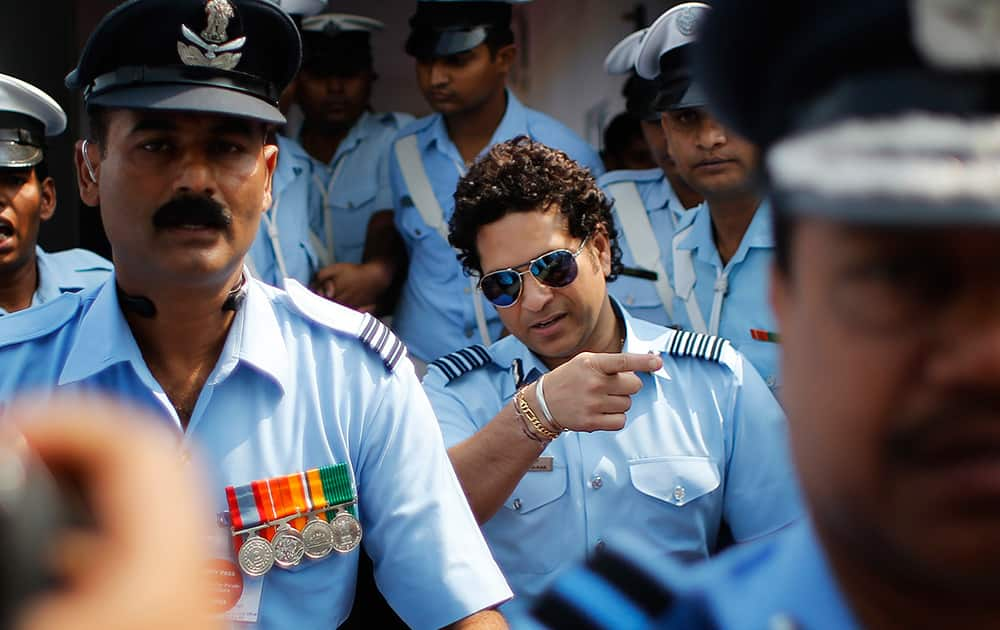 Former Indian cricketer and honorary Indian Air Force Group Captain Sachin Tendulkar, leaves after an Air Force Day parade at the air force station in Hindon near New Delhi.