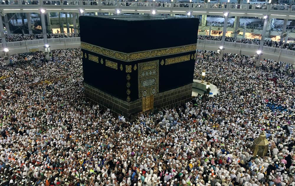 Muslim pilgrims circle the Kaaba, the black cube at center, inside the Grand Mosque during the annual pilgrimage, known as the hajj, in the Muslim holy city of Mecca, Saudi Arabia.