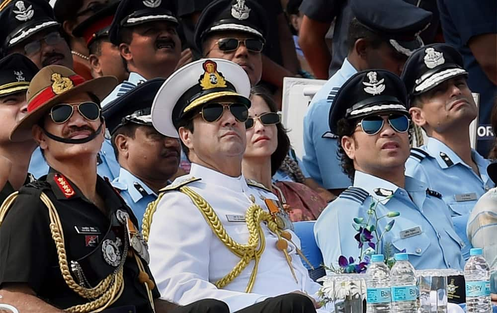 Sachin Tendulkar, cricket legend and honorary Group Captain in IAF with Navy Chief Admiral RK Dhowan and Army chief Gen Dalbir Singh Suhag during the 82nd Air Force Day function at Air Force Station Hindon in Ghaziabad.