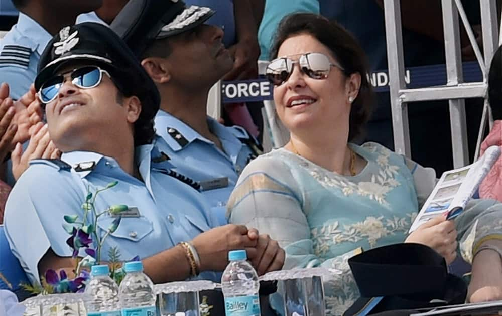 Sachin Tendulkar, cricket legend and honorary Group Captain in IAF and his wife Anjali during the 82nd Air Force Day function at Air Force Station Hindon in Ghaziabad.