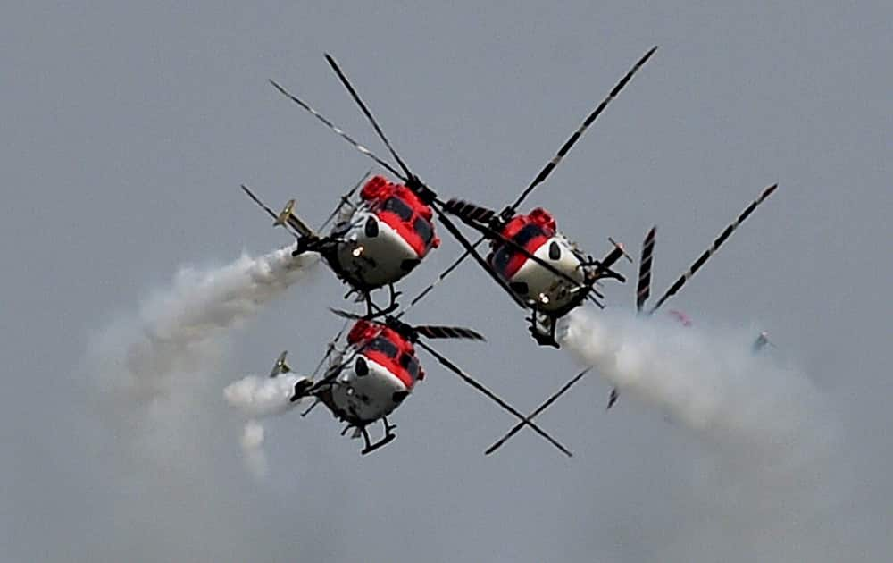Sarang helicopters fly in a formation during the 82nd Air Force Day function at Air Force Station Hindon in Ghaziabad.