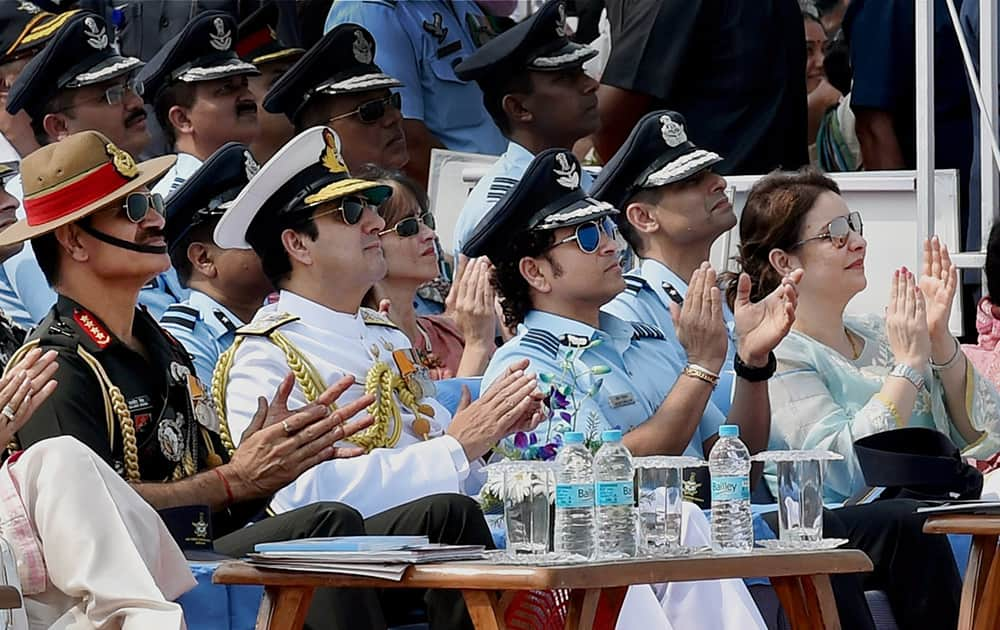 Sachin Tendulkar, cricket legend and honorary Group Captain in IAF and his wife Anjali with Navy Chief Admiral RK Dhowan and Army chief Gen Dalbir Singh Suhag during the 82nd Air Force Day function at Air Force Station Hindon in Ghaziabad.