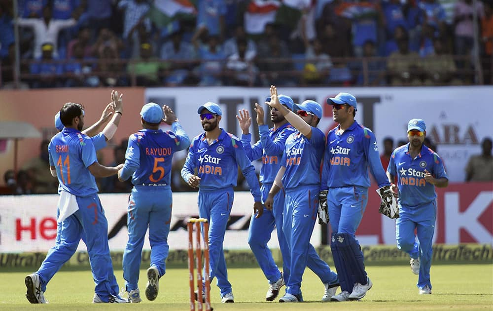 Indian players celebrating the wicket of West Indies Captain Dwayne Bravo during their first ODI match at Jawaharlal Nehru Stadium in Kochi.