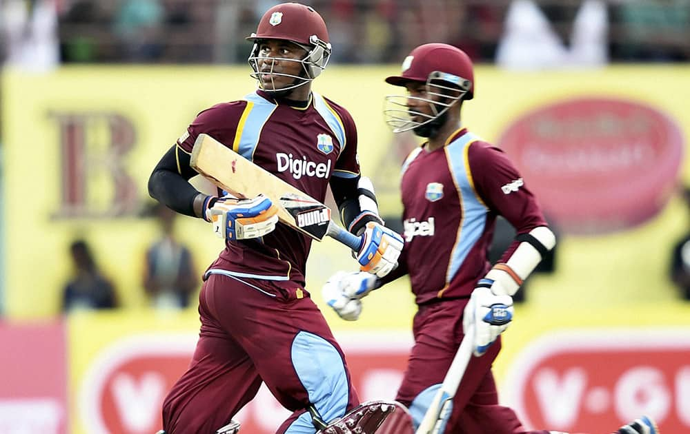 West Indies cricketer Marlon Samuels and D Ramdin during the first ODI match against India at Jawaharlal Nehru Stadium in Kochi.