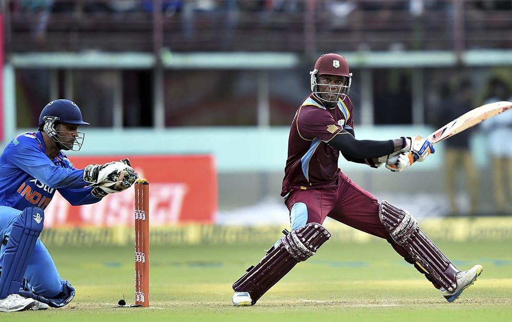 West Indies cricketer Marlon Samuels plays a shot against India during their first ODI match at Jawaharlal Nehru Stadium in Kochi.