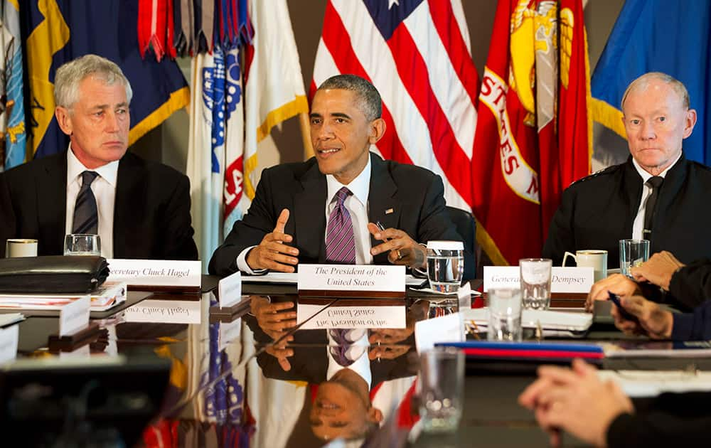 President Barack Obama, flanked by Defense Secretary Chuck Hagel, left, and Joint Chiefs Chairman Gen. Martin Dempsey, speaks to the media at the conclusion of a meeting with senior military leadership.