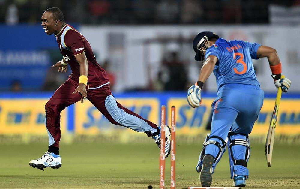 West Indies cricket team captain Dwayne Bravo celebrating for the wicket of Indias Suresh Raina during the first ODI match at Jawaharlal Nehru Stadium in Kochi.