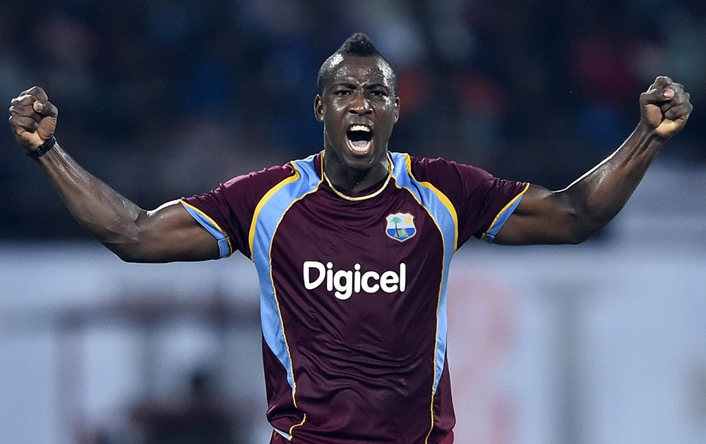 West Indies cricketer Andre Russell celebrating for the wicket of Indias Ambati Rayudu during the first ODI match at Jawaharlal Nehru Stadium in Kochi.