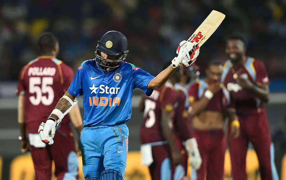 Shikhar Dhawan reacts after lost his wicket against West Indies during the first ODI match at Jawaharlal Nehru Stadium in Kochi.