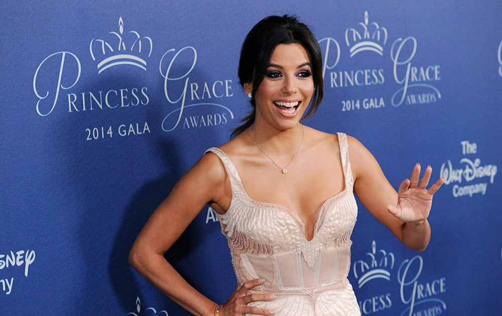 Actress Eva Longoria waves to photographers at the 2014 Princess Grace Awards Gala at the Beverly Wilshire Hotel, in Beverly Hills, Calif.