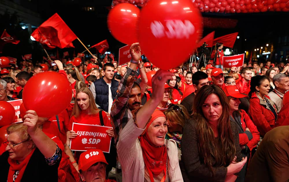 Supporters of the Social Democratic Party (SDP) wave flags and balloons during a final pre-election rally in Sarajevo, Bosnia.