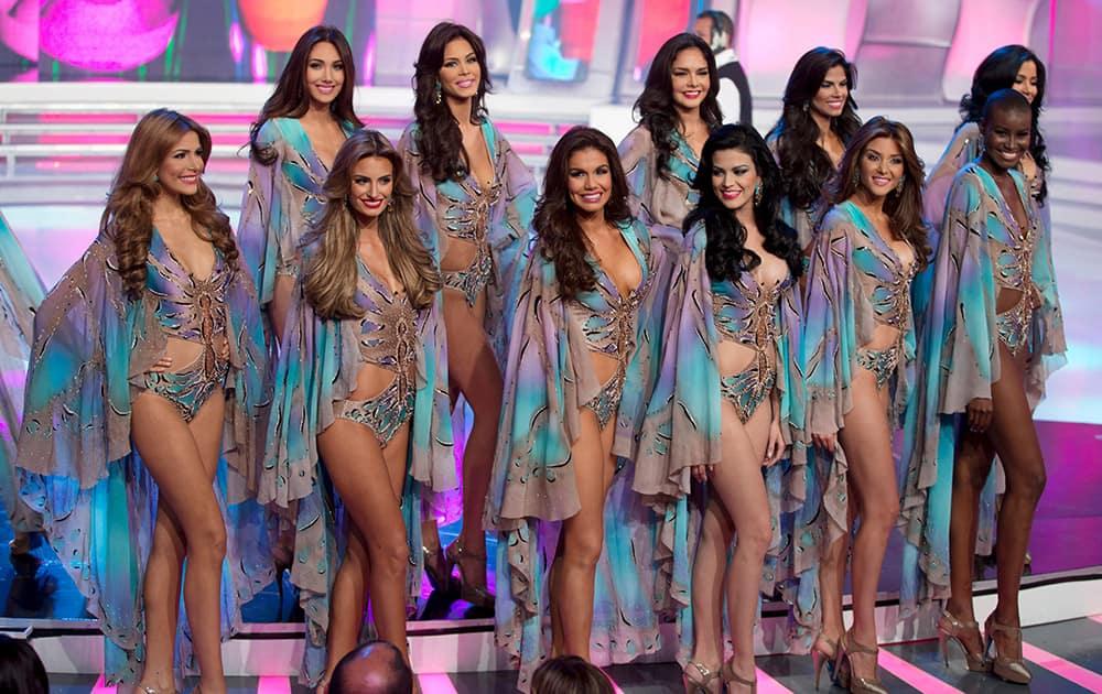 Miss Venezuela contestants pose in swim wear during the Miss Venezuela 2014 beauty pageant in Caracas, Venezuela.