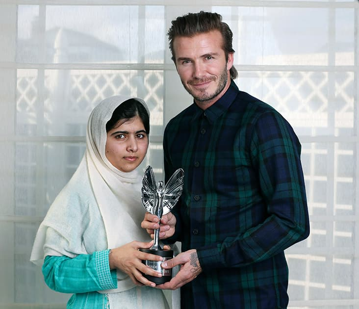 File Photo: David Beckham presents a Mirror Pride of Britain Teenager of Courage Award to Malala Yousafzai, Pakistani schoolgirl who was shot by the Taliban for going to school.
