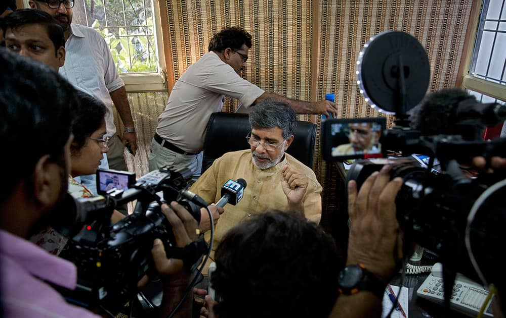 Indian children's rights activist Kailash Satyarthi speaks to the media at his office in New Delhi. Malala Yousafzai of Pakistan and Satyarthi of India jointly won the Nobel Peace Prize for risking their lives to fight for children's rights.