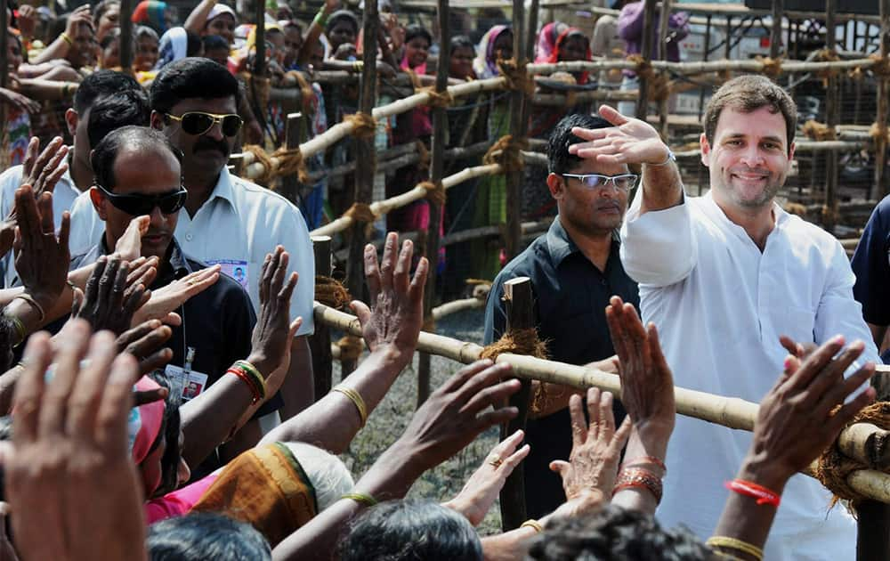 Congress Vice-President Rahul Gandhi meets his supporters during an election rally at Vani in Nasik district.