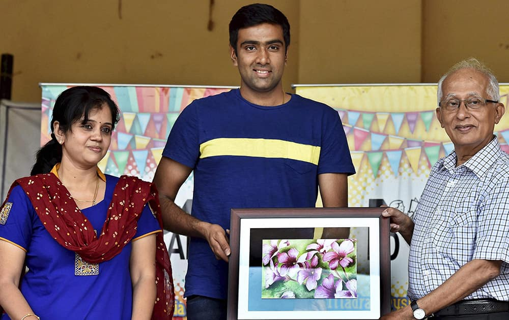 Cricketer R Ashwin is presented with a portrait at a programme where he was made the Goodwill Ambassador of the Madras Dyslexia Association in Chennai.