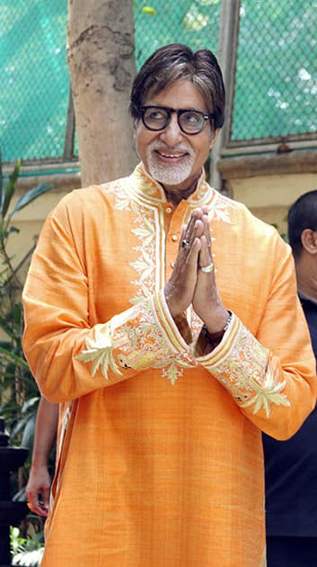 Bollywood mega star Amitabh Bachchan gestures while celebrating his 72nd birthday with the media at his office Janak in Mumbai.