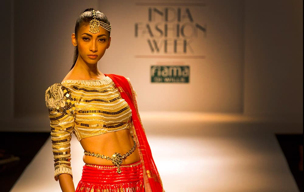 An Indian model displays a creation by designer Poonam Dubey during Wills Lifestyle India Fashion Week, in New Delhi.