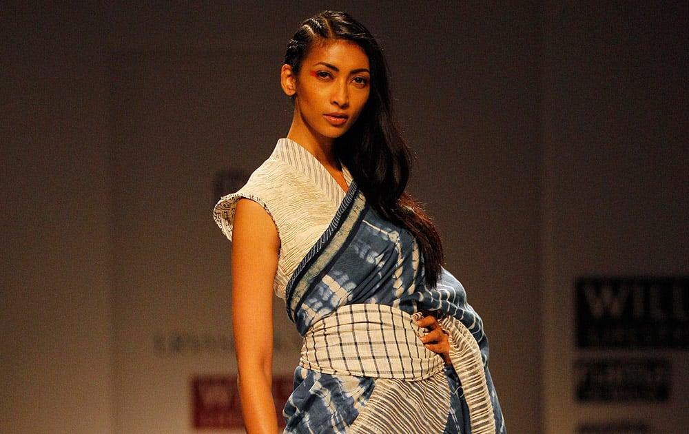 An Indian model displays a creation by designer Urvashi Kaur during Wills Lifestyle India Fashion Week, in New Delhi.