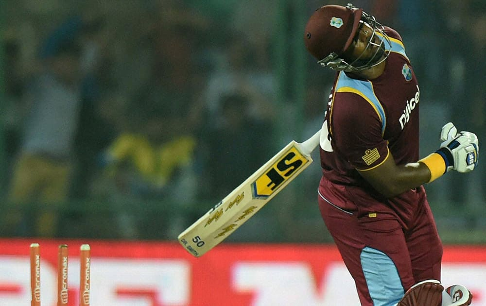 West Indies D Smith reacts after bowled by Indias M Shami during the 2nd ODI cricket match in New Delhi.