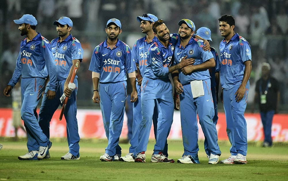 Indian cricketers celebrate after winning the 2nd ODI against West Indies in New Delhi.