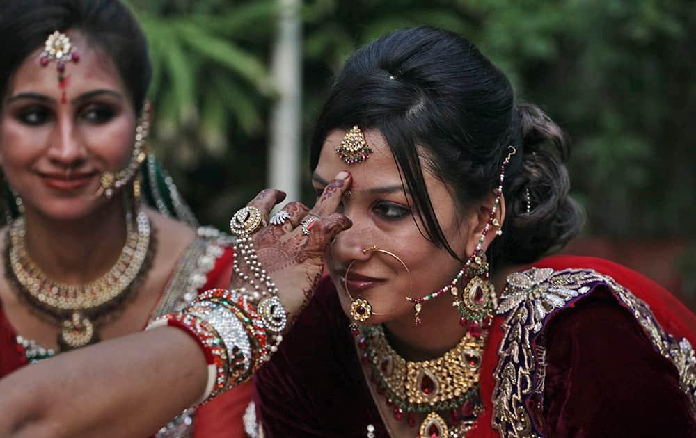 Indian Hindu married women perform rituals on Karva Chauth festival in Ahmadabad, India.