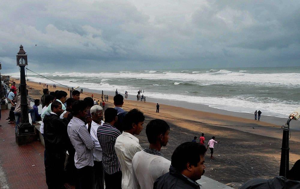 Onlookers looking at Sea tide at Gopalpur beach on the eve of Cyclone Hudhud hits land on Saturday. As per IMD bulletin , Hudhud will hit at Vishakhapatnam on Sunday noon.