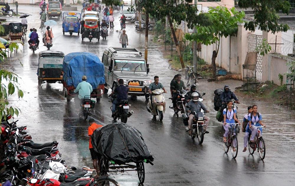 People move during rain near Gopalpur sea beach as effect of Cyclone Hudhud. The cyclone will land near Vishakhapatnam.