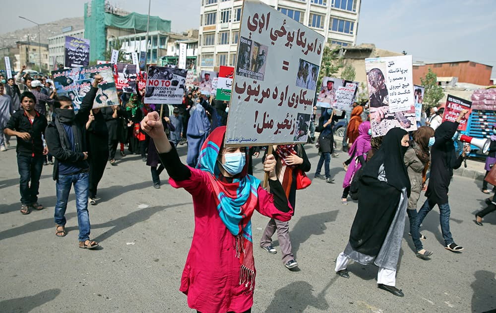 Members of the Solidarity Party of Afghanistan (SPA) shout slogans and wave banners against the presence of U. S. and NATO troops in their country and against the militant Islamic State group, in Kabul, Afghanistan.