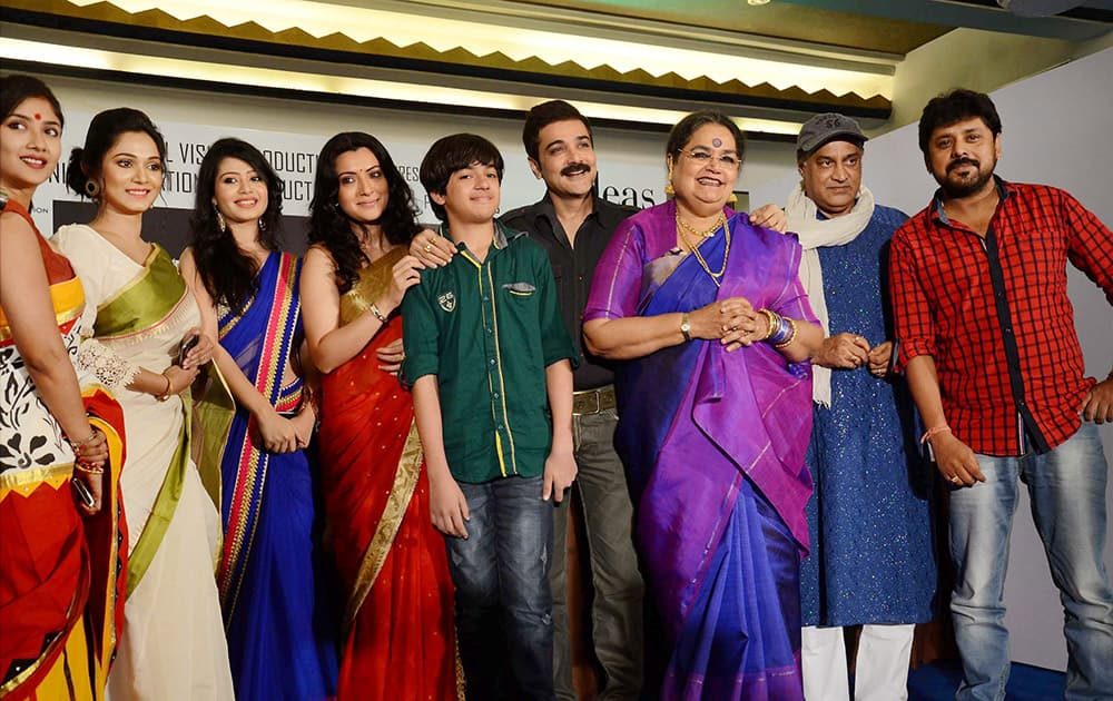 Bengals superstar Prosenjit Chatterjee with Pop icon Usha Uthup, film star Arpita Chatterjee, film Director Raza Chandra and other artists during a promotional event of their Bengali film Force in Kolkata.