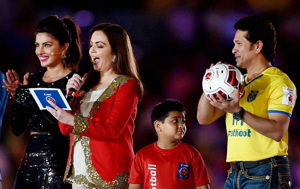 ISL Founding Chairperson Nita Ambani declare the Indian Super League (ISL) 2014 open as cricketer Sachin Tendulkar and bollywood actress Priyanka Chopra look on.