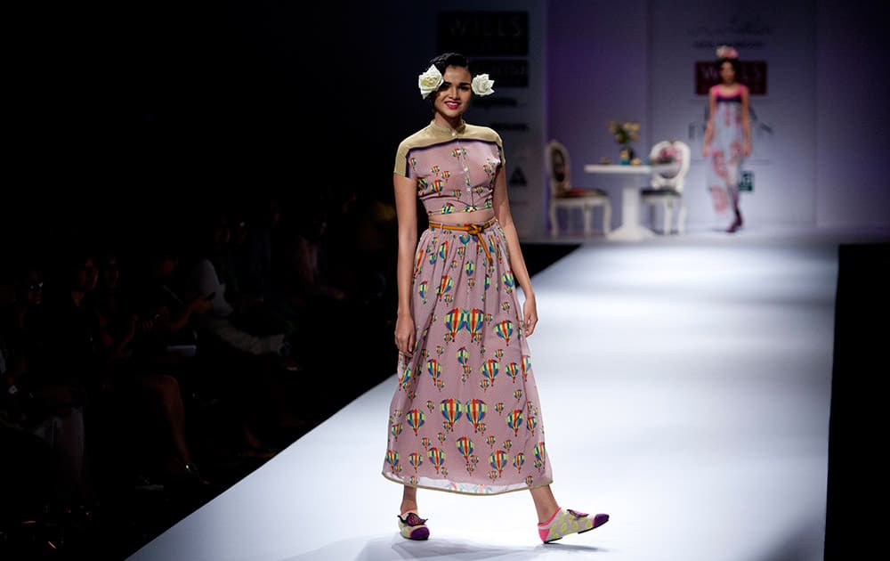 An Indian model displays a creation by designer Nida Mahmood during Wills Lifestyle India Fashion Week, in New Delhi.