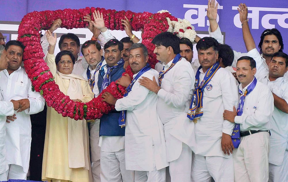 FORMER UTTAR PRADESH CHIEF MINISTER AND BAHUJAN SAMAJ PARTY SUPREMO, MAYAWATI BEING GARLANDED BY PARTY WORKERS DURING AN ELECTION RALLY IN FARIDABAD.