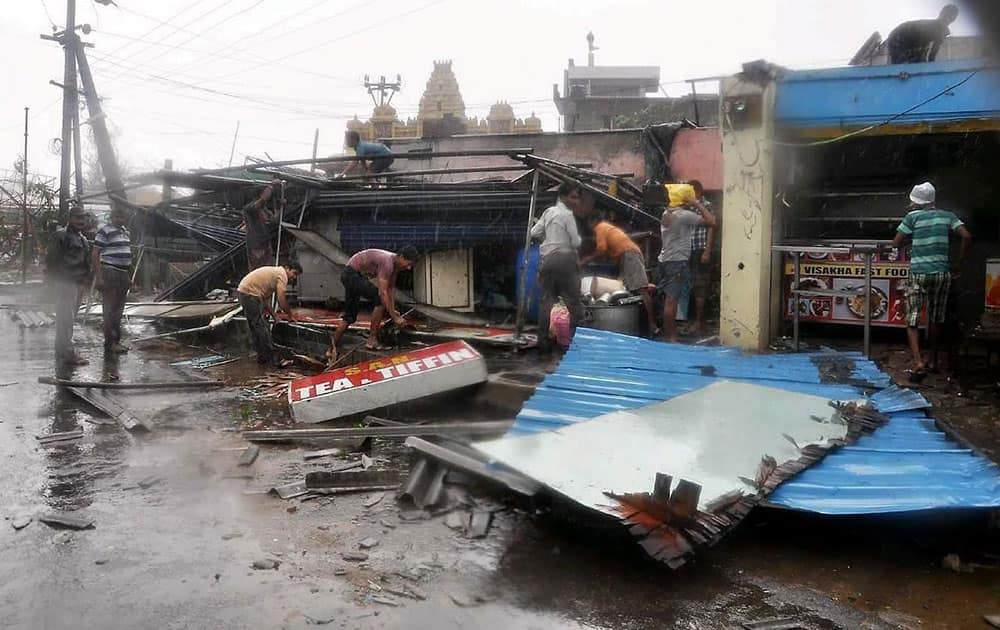 People sift through their damaged propery after Hudhud Cyclone in Vishakapatnam.