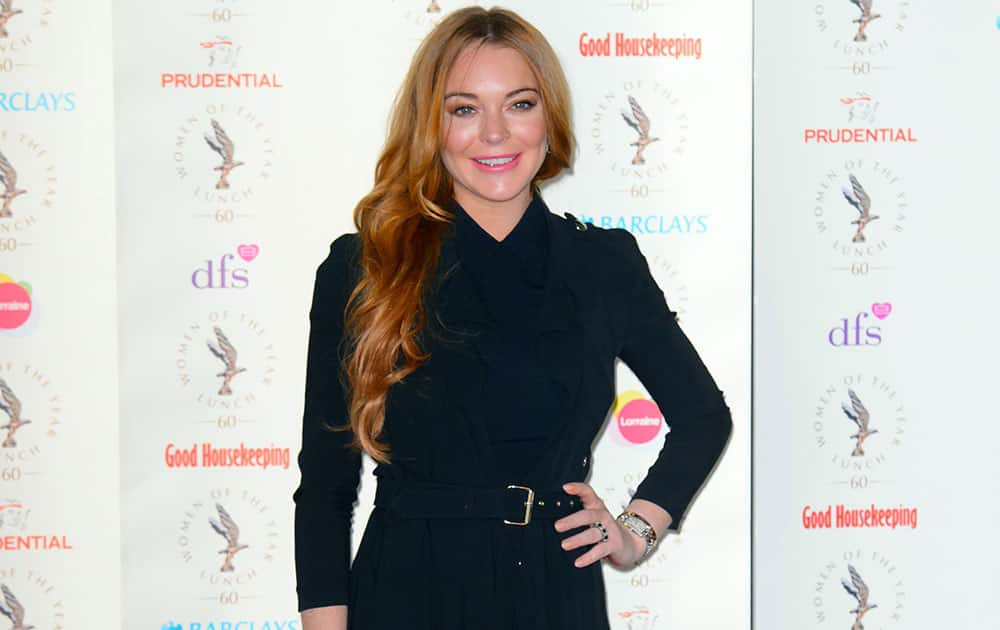 US actress Lindsay Lohan arrives for the Women of the Year Awards, at a central London venue, London.