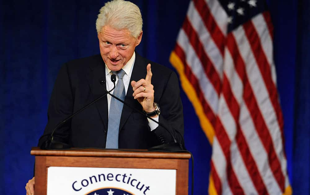 Former President Bill Clinton gestures as he speaks at a rally for Gov. Dannel P. Malloy, in Hartford, Conn.