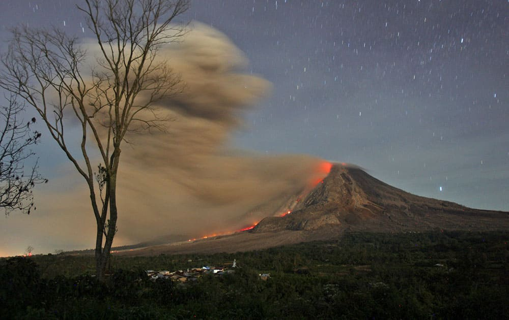 Mount Sinabung spews hot lava and volcanic ash as seen from Jeraya, North Sumatra, Indonesia. Mount Sinabung, among about 130 active volcanoes in Indonesia, has sporadically erupted since 2010 after being dormant for 400 years.