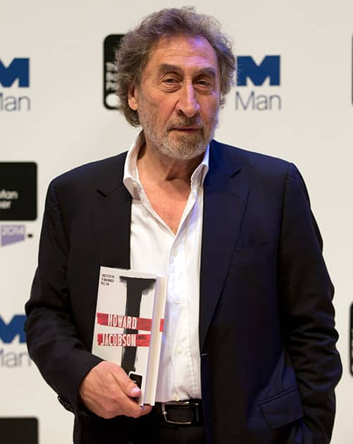 Man Booker prize 2014 nominee British author Howard Jacobson holds his book 'J', during a photocall for the Man Booker Prize for fiction 2014 at the Royal Festival Hall in London.