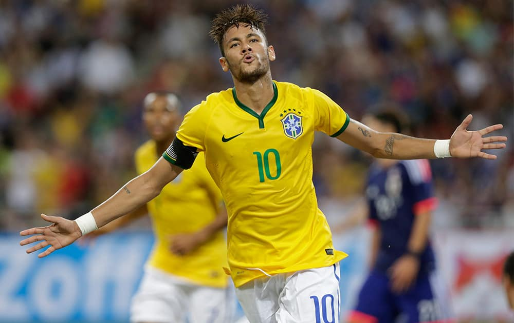 Brazil's Neymar celebrates after scoring his fourth goal against Japan during an international friendly soccer match in Singapore.